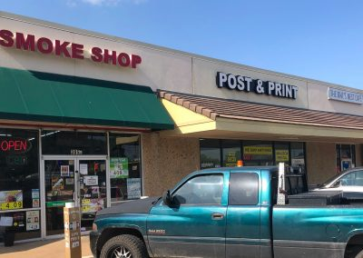 Cathy's Smoke Shop, a smoke shop, and Post & Print, a shipping store, located in the Joshua Shopping Center in Joshua TX