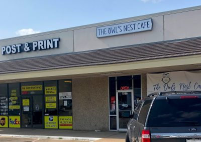 Post & Print, a shipping store, and The Owl's Nest Cafe, a restaurant, both located in the Joshua Shopping Center in Joshua TX