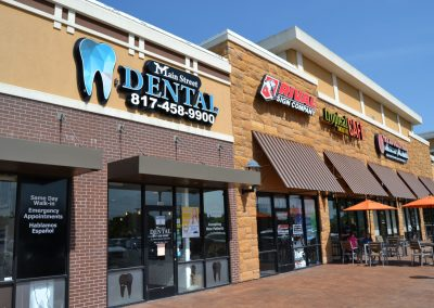 Main Street Plaza shopping center in Weatherford Texas, featuring Main Street Dental, Rival Sign Company, and Tropical Smoothie Cafe