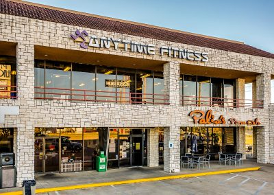 Park Place Plaza shopping center featuring tenants Anytime Fitness and Palio's Pizza in Azle TX