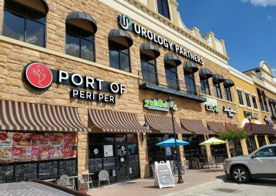 The Village at Sports Center in Arlington Texas, showcasing tenants Port of Peri Peri, Yumilicious Frozen Yogurt, and Urology Partners