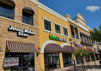 The Village at Sports Center in Arlington Texas, showcasing tenants Jersey Mike's Subs and Ideal Dental