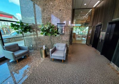 Lobby of Campus Office Tower in Fort Worth TX and the entrance to Dwell Coffee & Biscuits