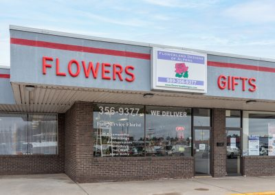 Flowerland Designs, a florist in the Thunder Bay shopping center in Alpena MI