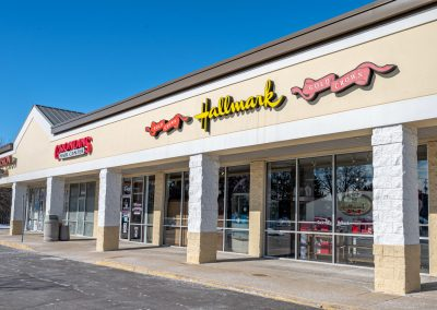 Hallmark, Grondin's Hair Center, and Frazier Vision Center, tenants in the West Acres Commons shopping center in Flint Township, MI
