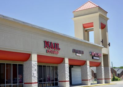 Nail Studio, ATL Braids & Barbers, and Fam Cell Phone, three stores in the Montgomery Commons shopping center in Montgomery AL