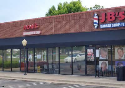 Heritage Plaza shopping center in Midwest City Oklahoma featuring JB's Barber Shop and Ron's Hamburgers & Chili