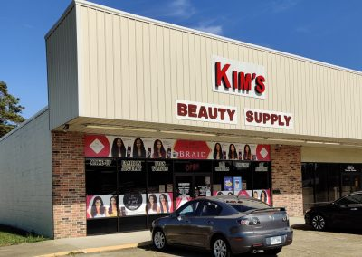 Pine Plaza shopping center in Crossett AR featuring tenant Kim's Beauty Supply